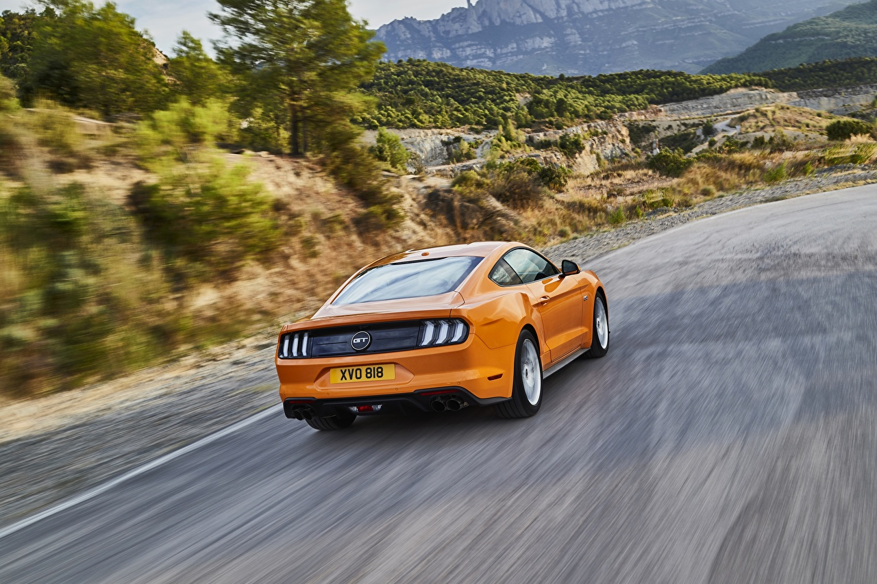 Photos Ford 2018 Mustang GT 5.0 Orange driving Back view automobile moving riding Motion at speed Cars auto