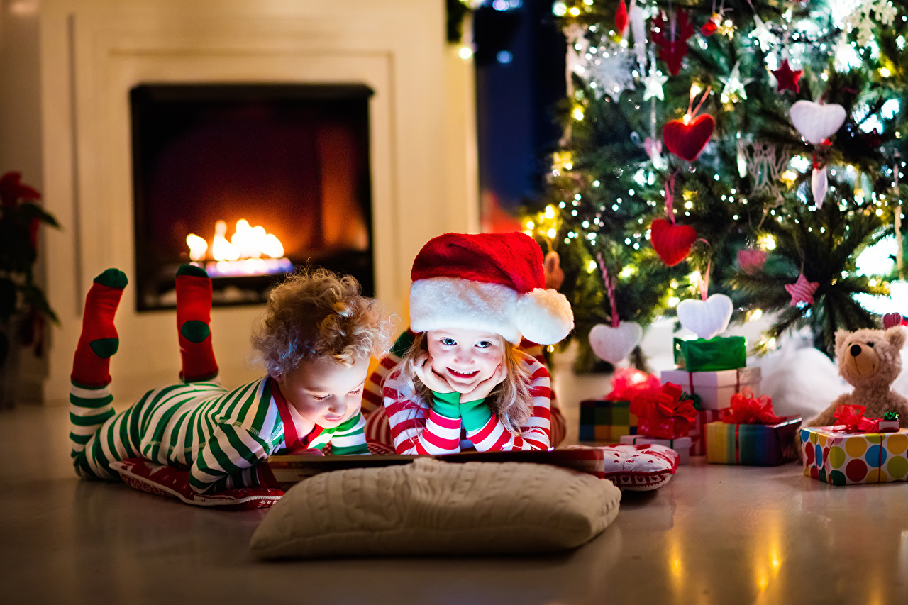 Pictures Little girls Boys New year Children Winter hat Christmas tree Fireplace Holidays Christmas child New Year tree
