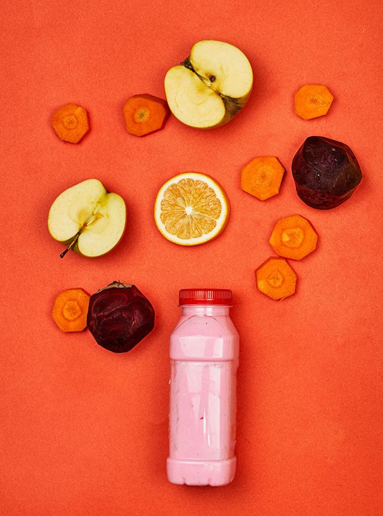 Photo Beet Yogurt Carrots Apples Food Bottle Colored background  for Mobile phone beetroot bottles