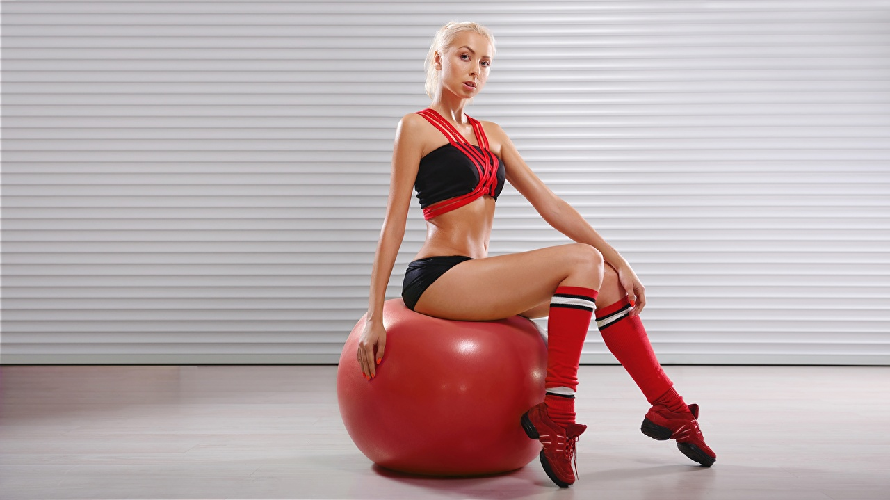Photos Blonde girl Fitness Sport female Legs Ball Sitting Glance Girls sports athletic young woman sit Staring