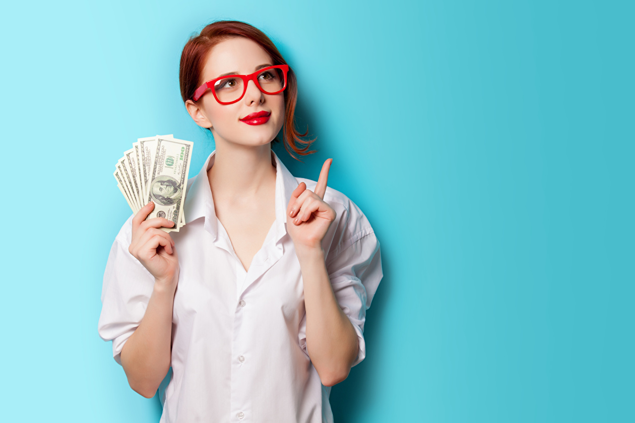 Image Dollars Redhead girl Girls Formal shirt Money Hands Glasses Staring Red lips Colored background female young woman eyeglasses Glance