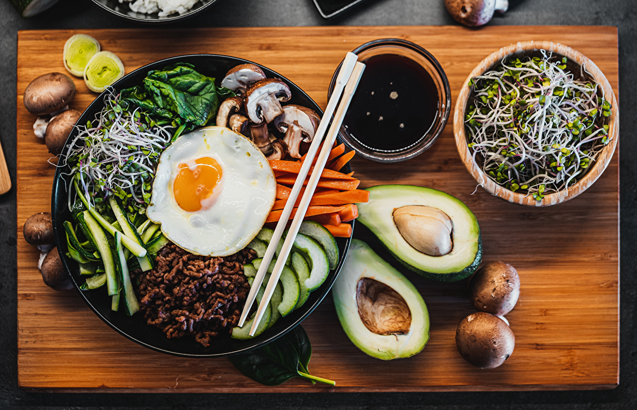 Wallpaper Bibimbap Fried egg Bowl Avocado Mushrooms Food Chopsticks Sliced food Cutting board