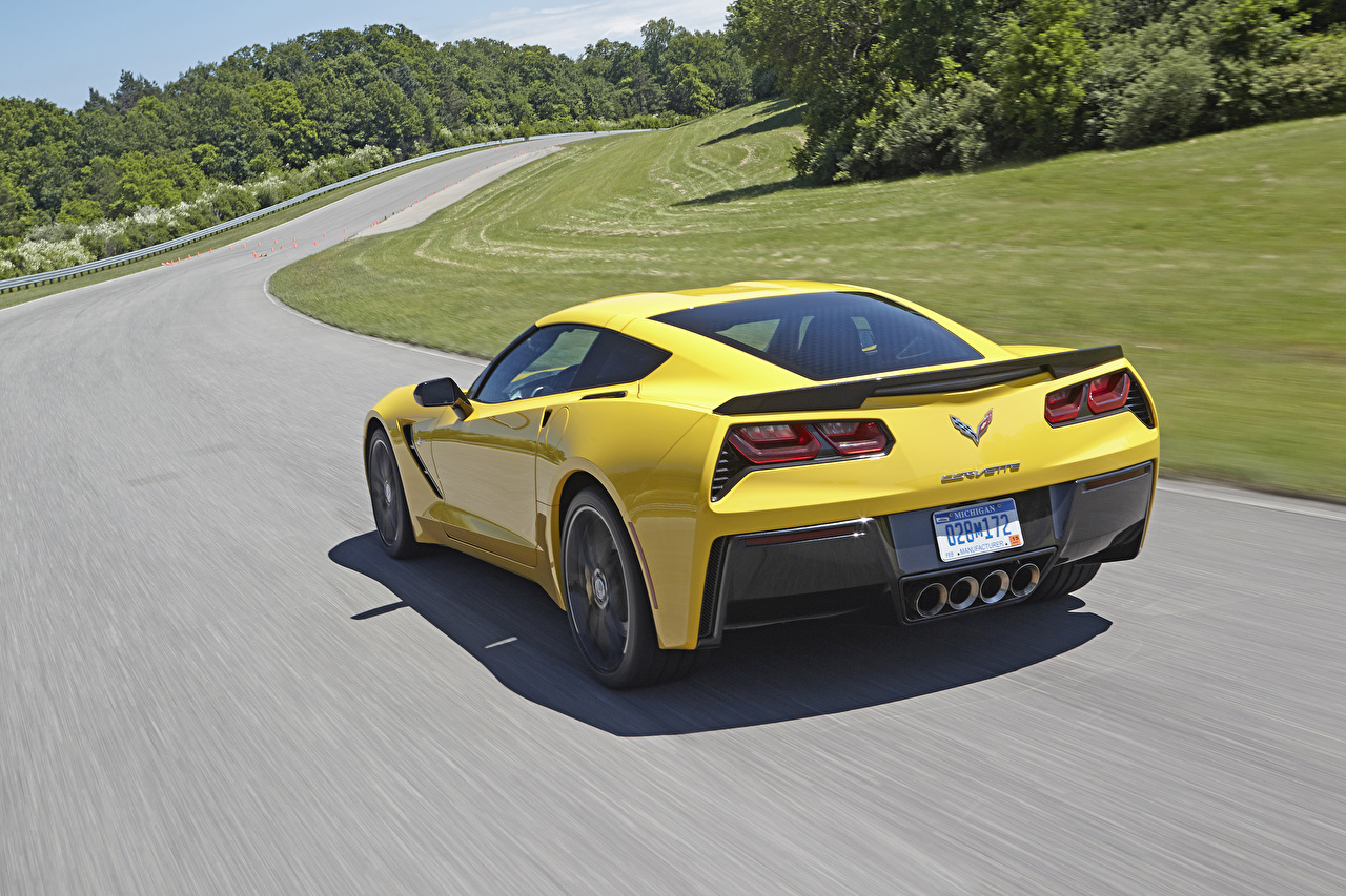 Photo Chevrolet Corvette c7 Stingray Yellow Roads Motion auto Back view moving riding driving at speed Cars automobile