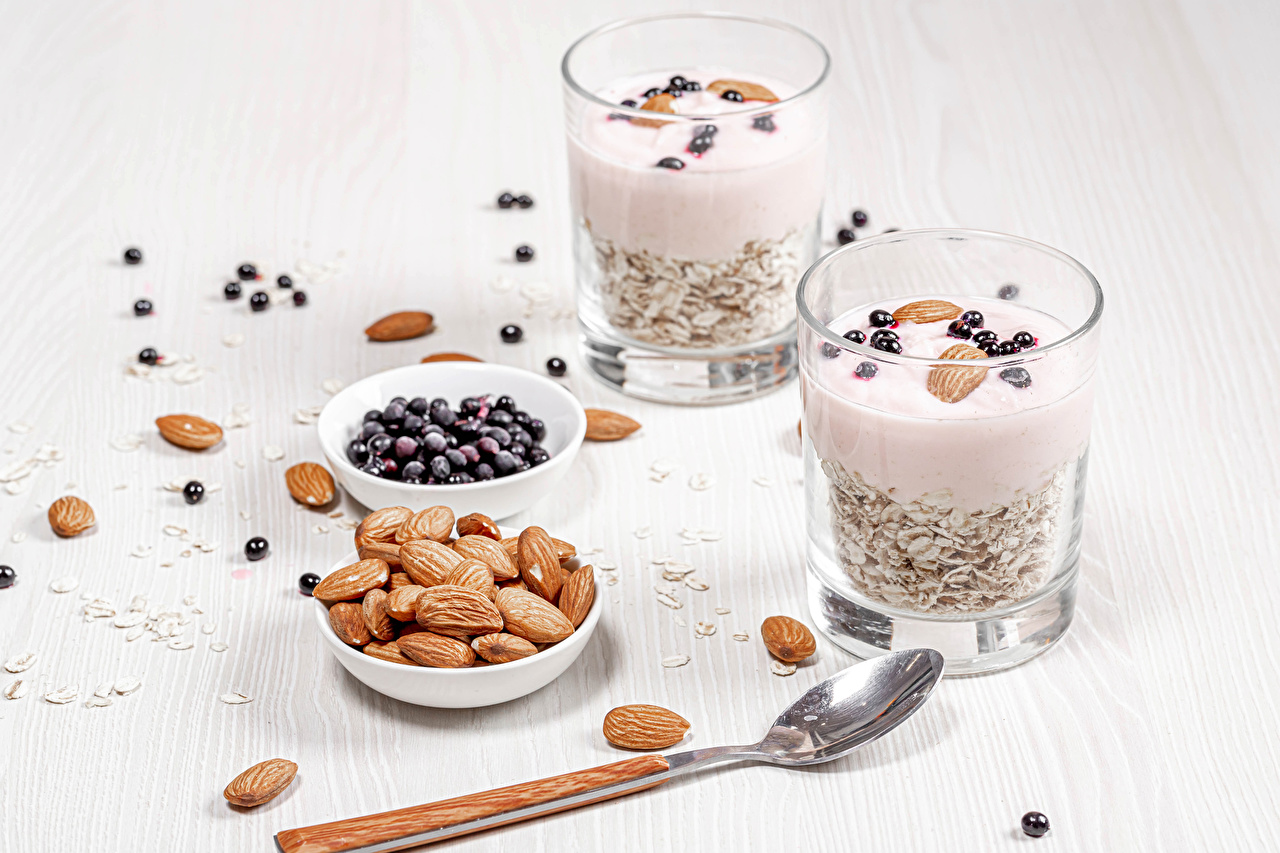 Photos Almond Yogurt Currant Highball glass Food Spoon Muesli Nuts