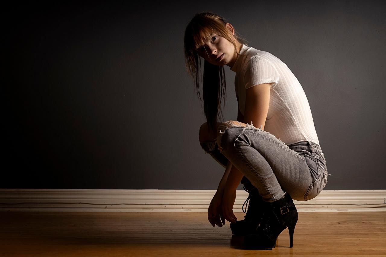 Photo Rebekka Weigand Girls T-shirt Jeans sit Staring female young woman Sitting Glance