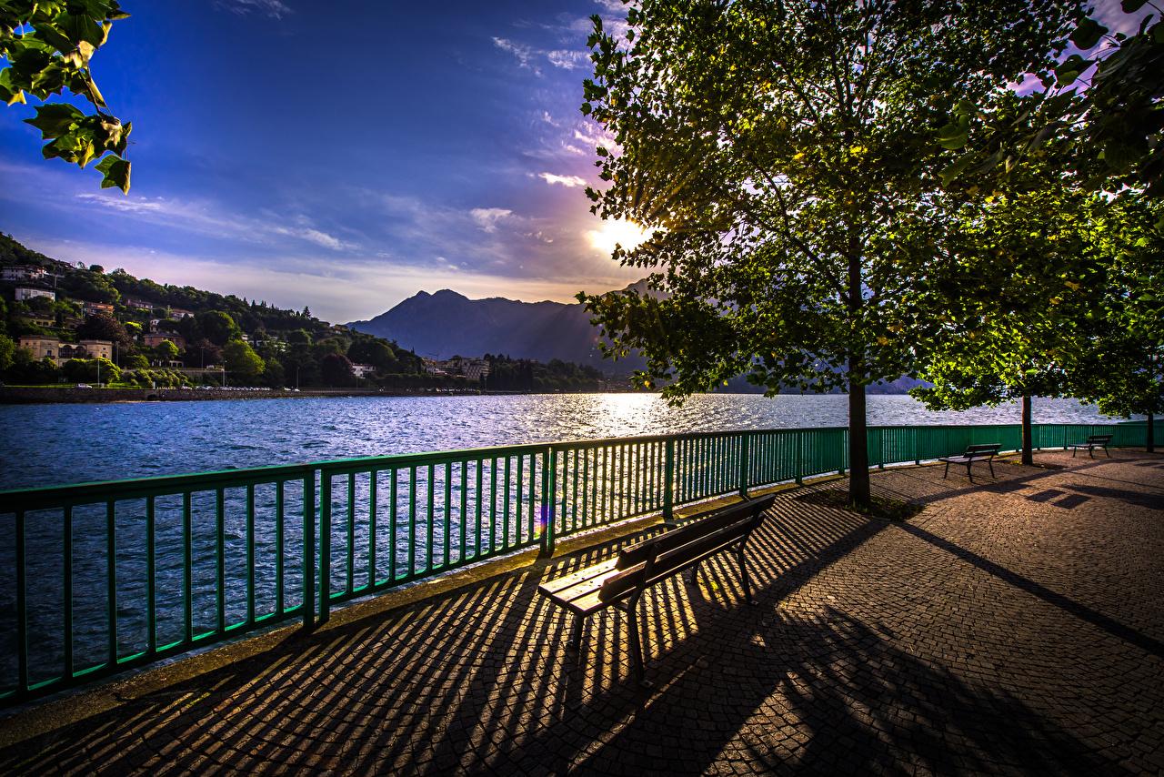 Fotos von Italien Schatten Como Natur See Zaun Sonnenaufgänge und Sonnenuntergänge Abend Bank (Möbel) Bäume