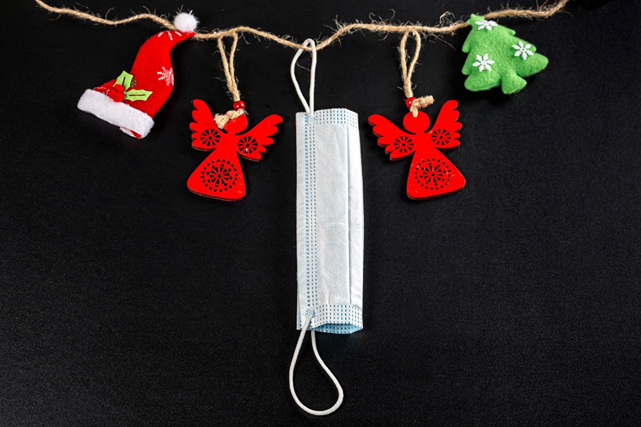 Skrivebordsbakgrunn Coronavirus jul Juletre Vinterhue engel Masker Svart bakgrunn Nyttår Engler maske