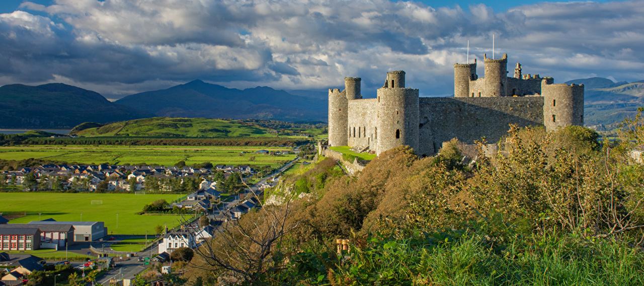 Fotos Wales Vereinigtes Königreich Türme Harlech Castle Burg Natur Gebirge Wolke Turm Berg