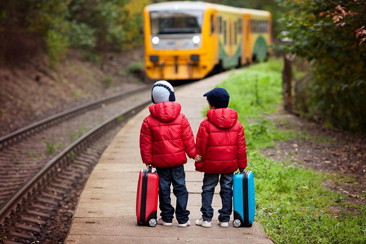Desktop Wallpapers Boys child Two Jacket Winter hat Jeans Suitcase Railroads Children 2
