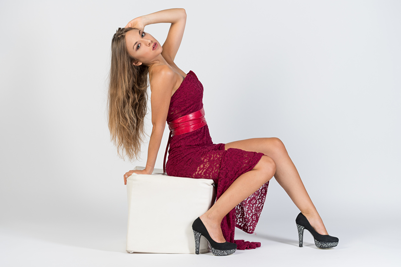 Image Anna posing Girls Legs Sitting Staring gown high heels Pose female young woman sit Glance frock Dress Stilettos