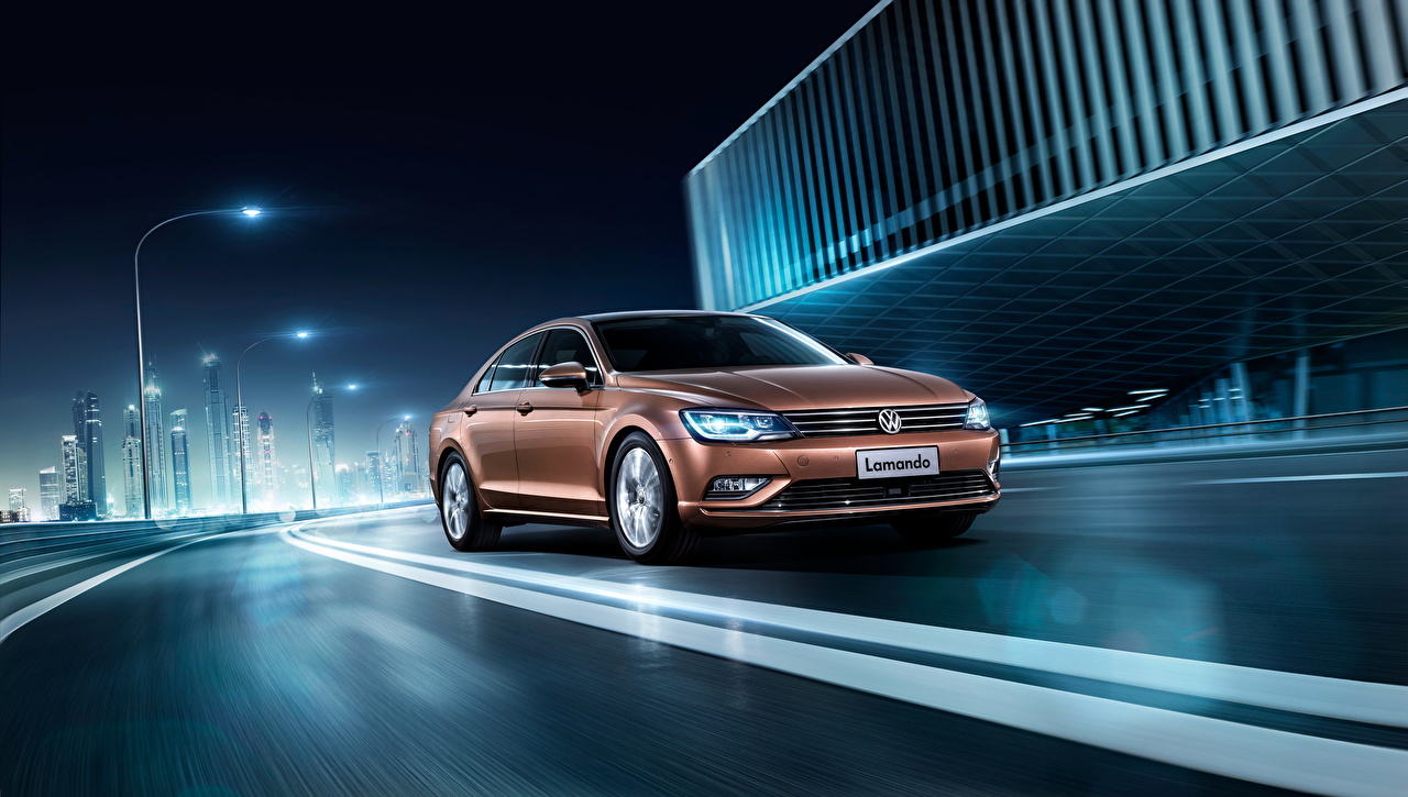 Image Volkswagen 2015 Lamando Brown Roads riding auto Night moving Motion driving at speed Cars night time automobile