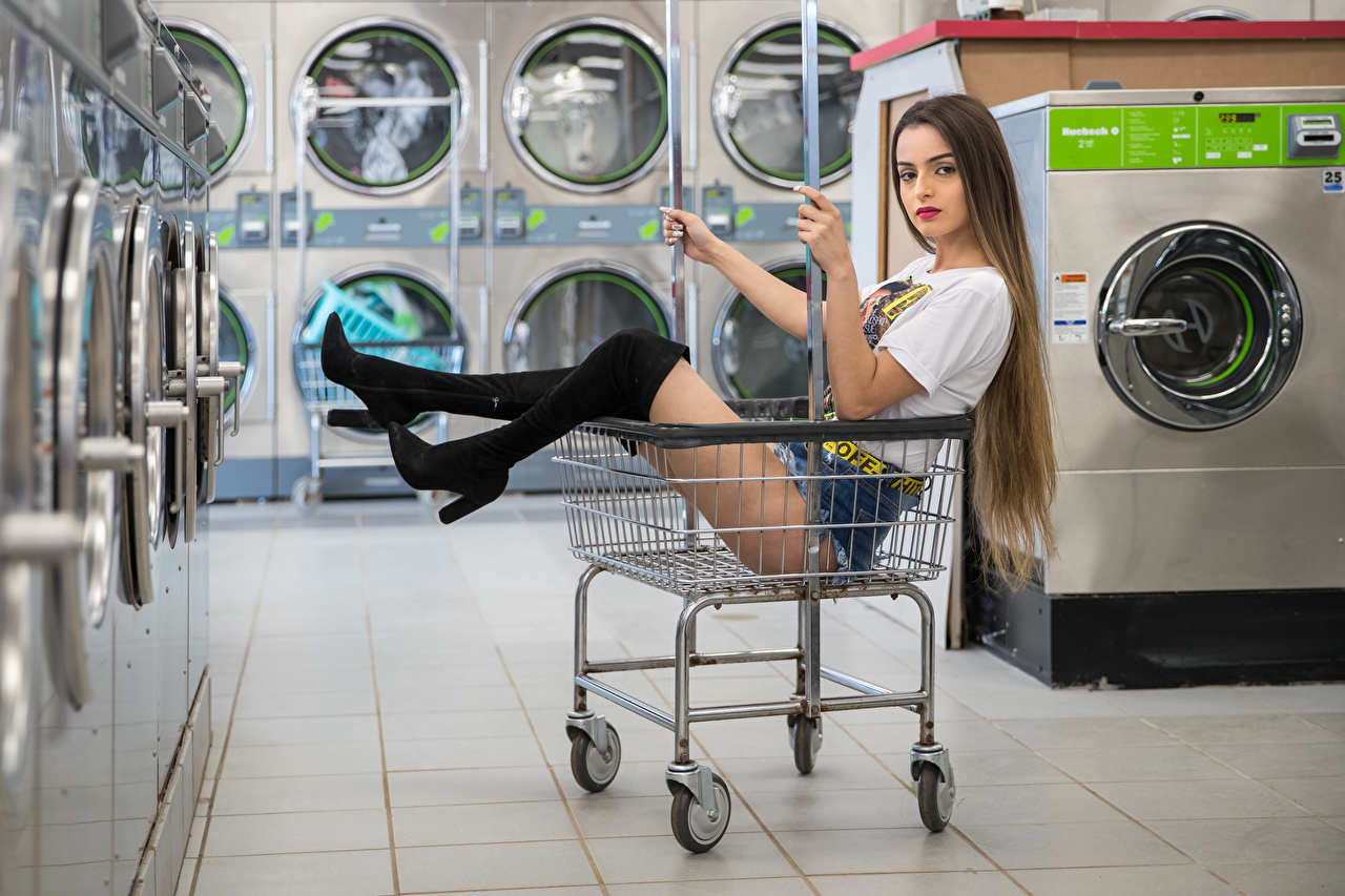 Image Modelling Wearing boots Alexis Contreras, laundry Girls T-shirt Legs Wicker basket Shorts Sitting Glance Model female young woman sit Staring