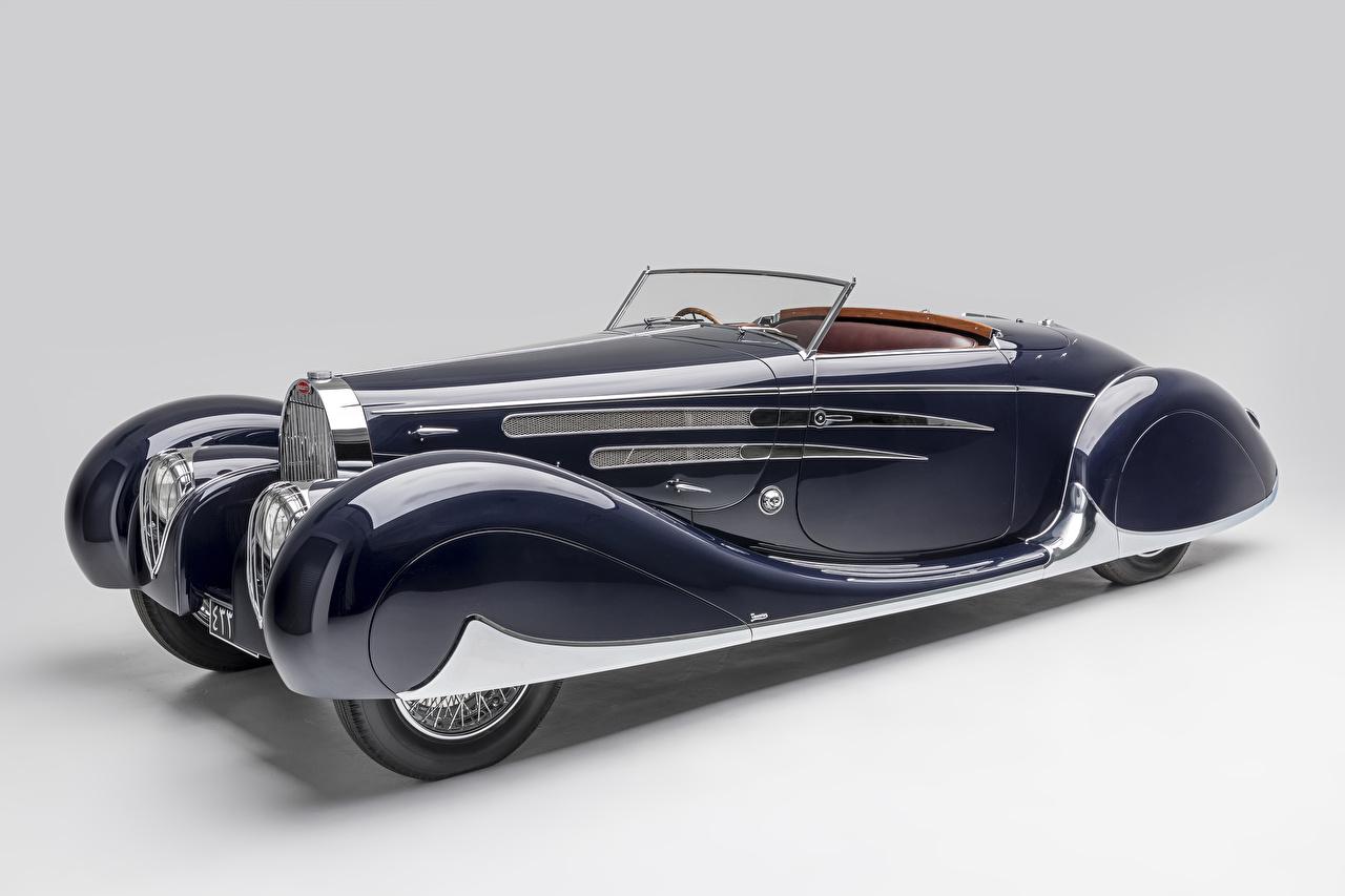 Photo BUGATTI 1939 Type 57C Cabriolet by Vanvooren Convertible Blue Retro automobile Gray background vintage antique Cars auto