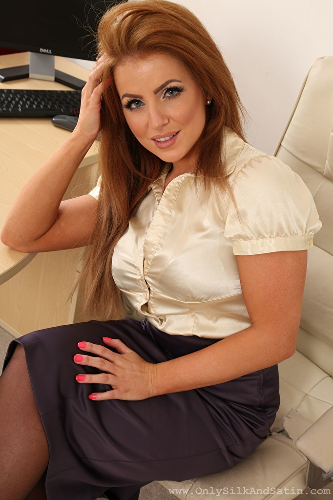 Picture Chloe Welsh Brown haired Secretaries female sit Hands Staring  for Mobile phone Girls young woman Sitting Glance