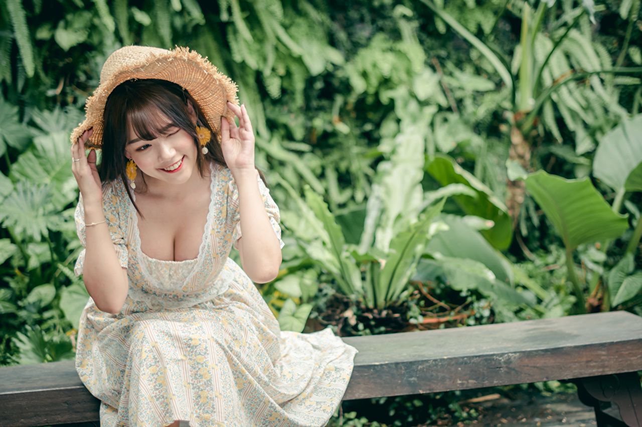 Photo Smile Bokeh decollete Hat young woman Asiatic Hands Sitting frock blurred background neckline Décolletage Girls female Asian sit gown Dress