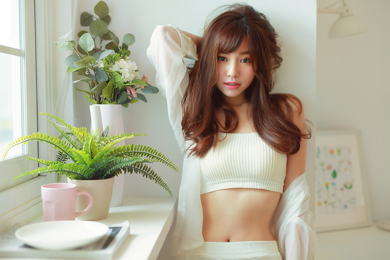 Image Brown haired Girls Asian Belly Glance female young woman Asiatic Staring