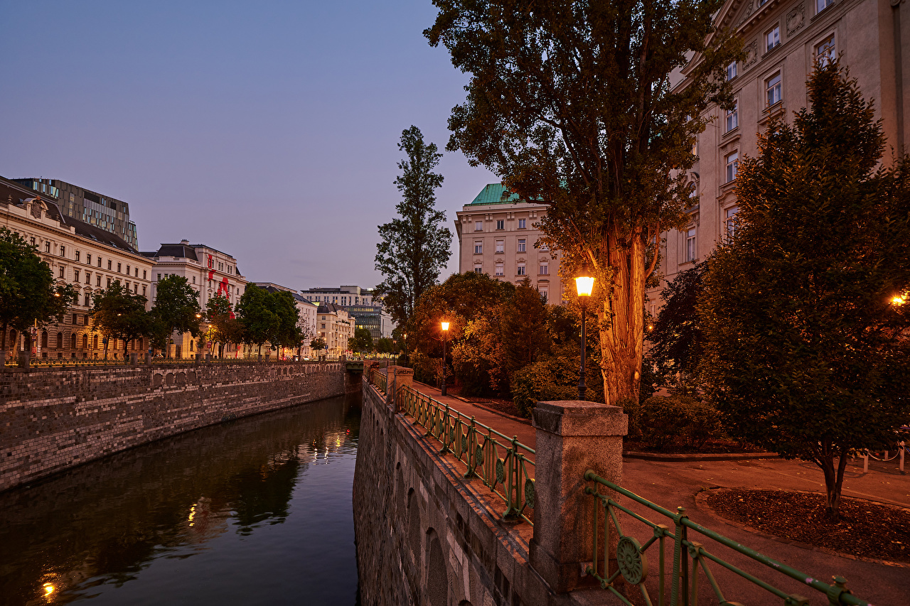 Image Vienna Austria Canal Street Evening Street lights Trees Houses Cities Building
