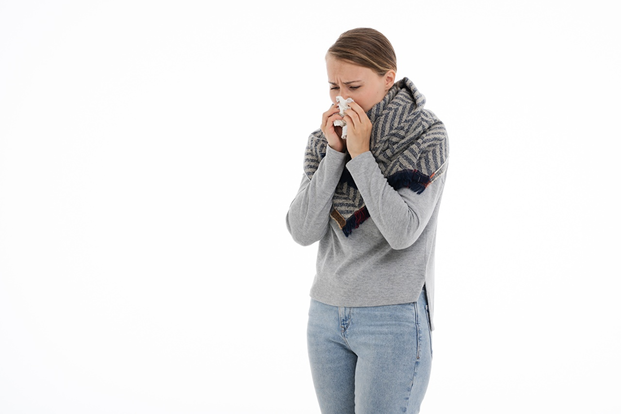 Picture young woman Brown haired runny nose, colds sick Jeans Hands White background Girls female Common cold