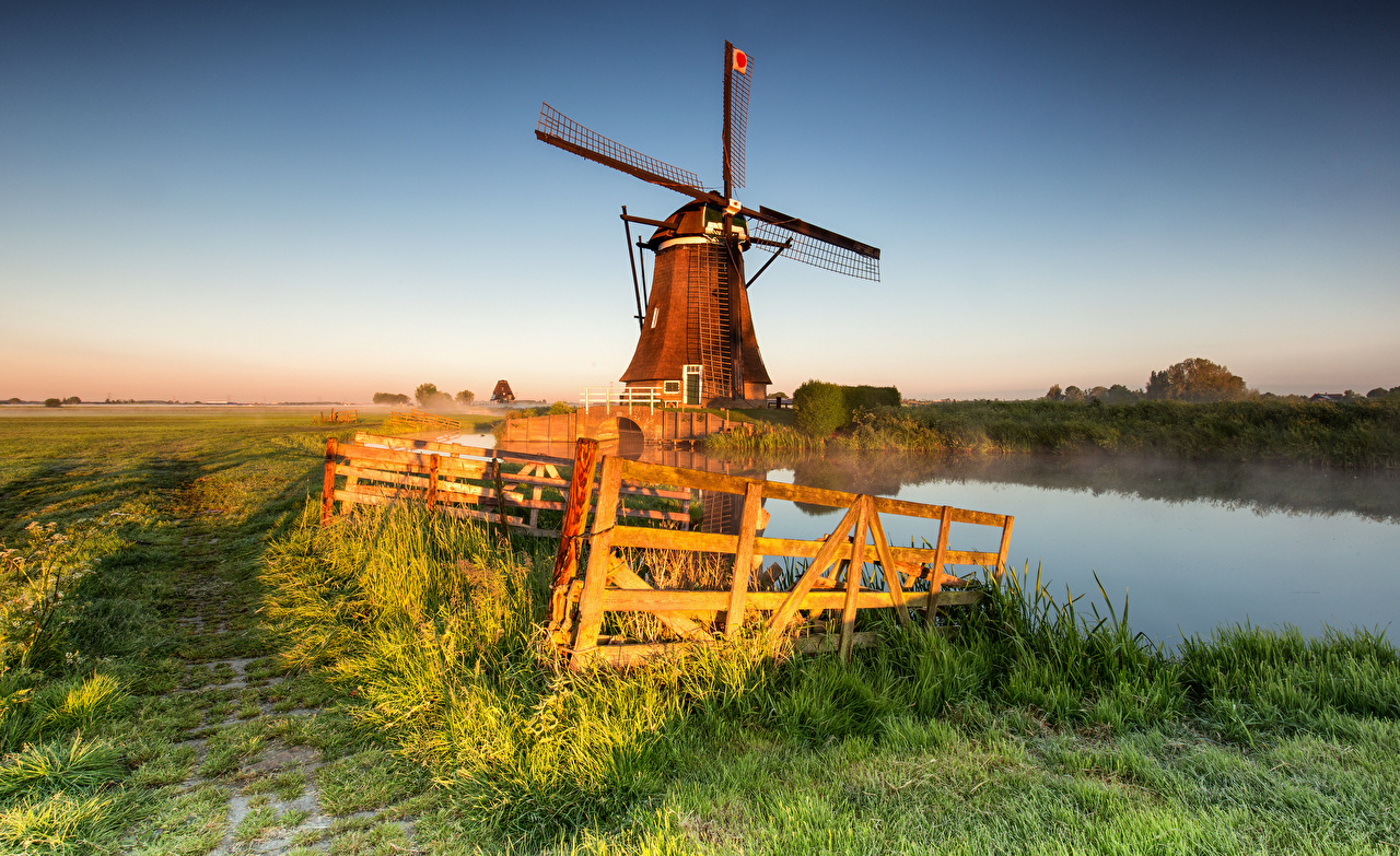 Picture Netherlands Mill Alblasserwaard, Streefkerk Fog Nature Fence Fields Morning windmill windmills