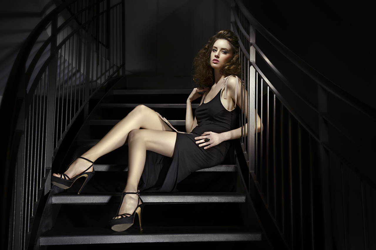Desktop Wallpapers Brown haired female stairway Legs Hands Sitting frock high heels Girls Stairs staircase young woman sit gown Dress Stilettos