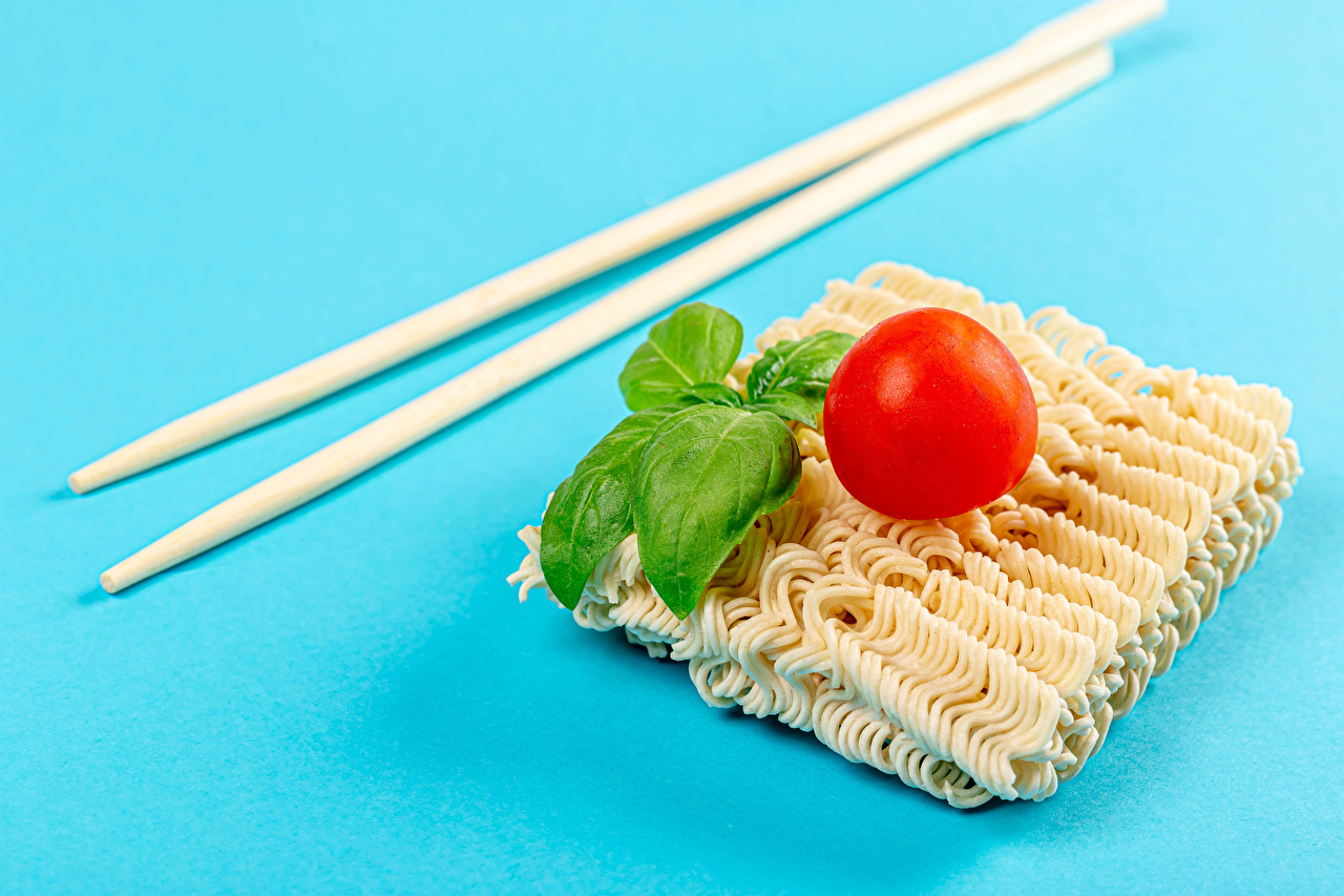 Pictures instant noodles Basil Tomatoes Food Chopsticks Colored background