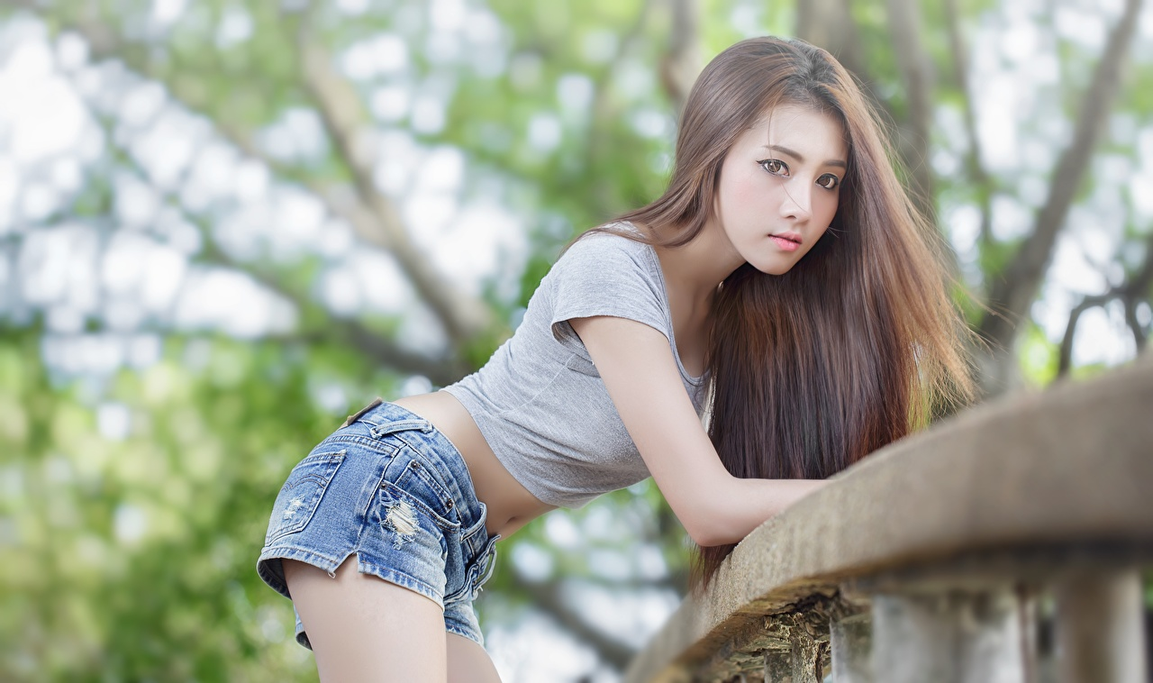 Image Brown haired Bokeh Pose female Asiatic Shorts Glance blurred background posing Girls young woman Asian Staring