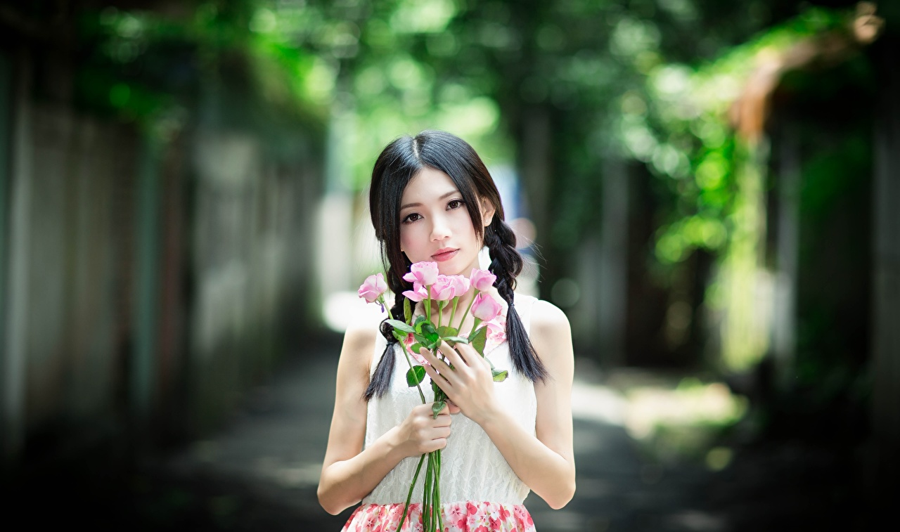 Desktop Wallpapers Brunette girl Bokeh bouquet rose young woman Asiatic Hands Glance blurred background Bouquets Roses Girls female Asian Staring
