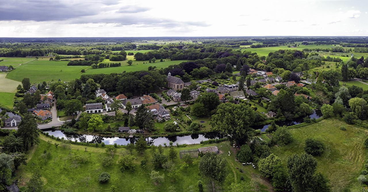 Picture Netherlands Village Diepenveen, Provincie Overijssel Fields Rivers From above Cities Building river Houses