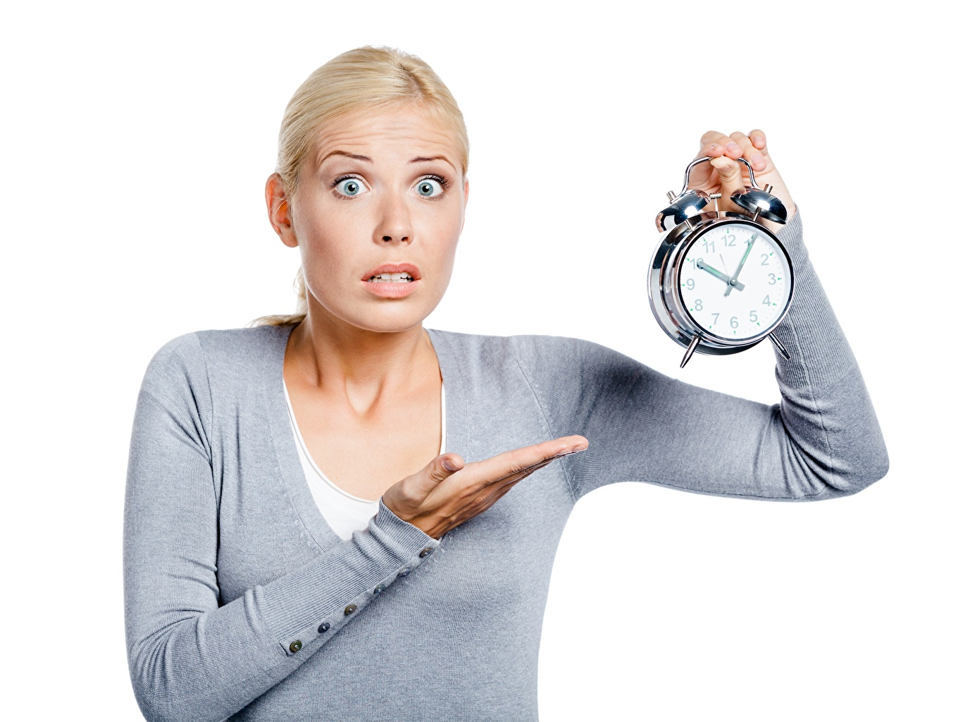 Wallpaper Blonde girl surprised Girls Alarm clock Hands White background amazement Surprise emotion female young woman