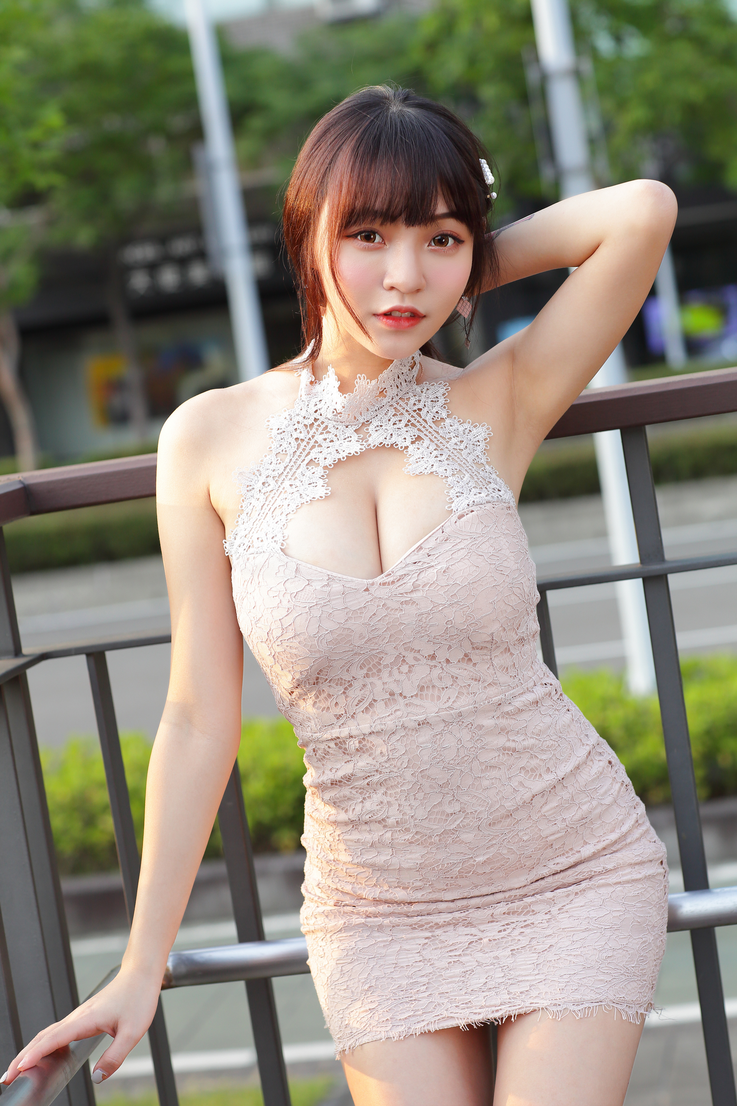 Pictures Pose decollete young woman Asian Hands Glance Dress  for Mobile phone posing neckline Décolletage Girls female Asiatic Staring gown frock