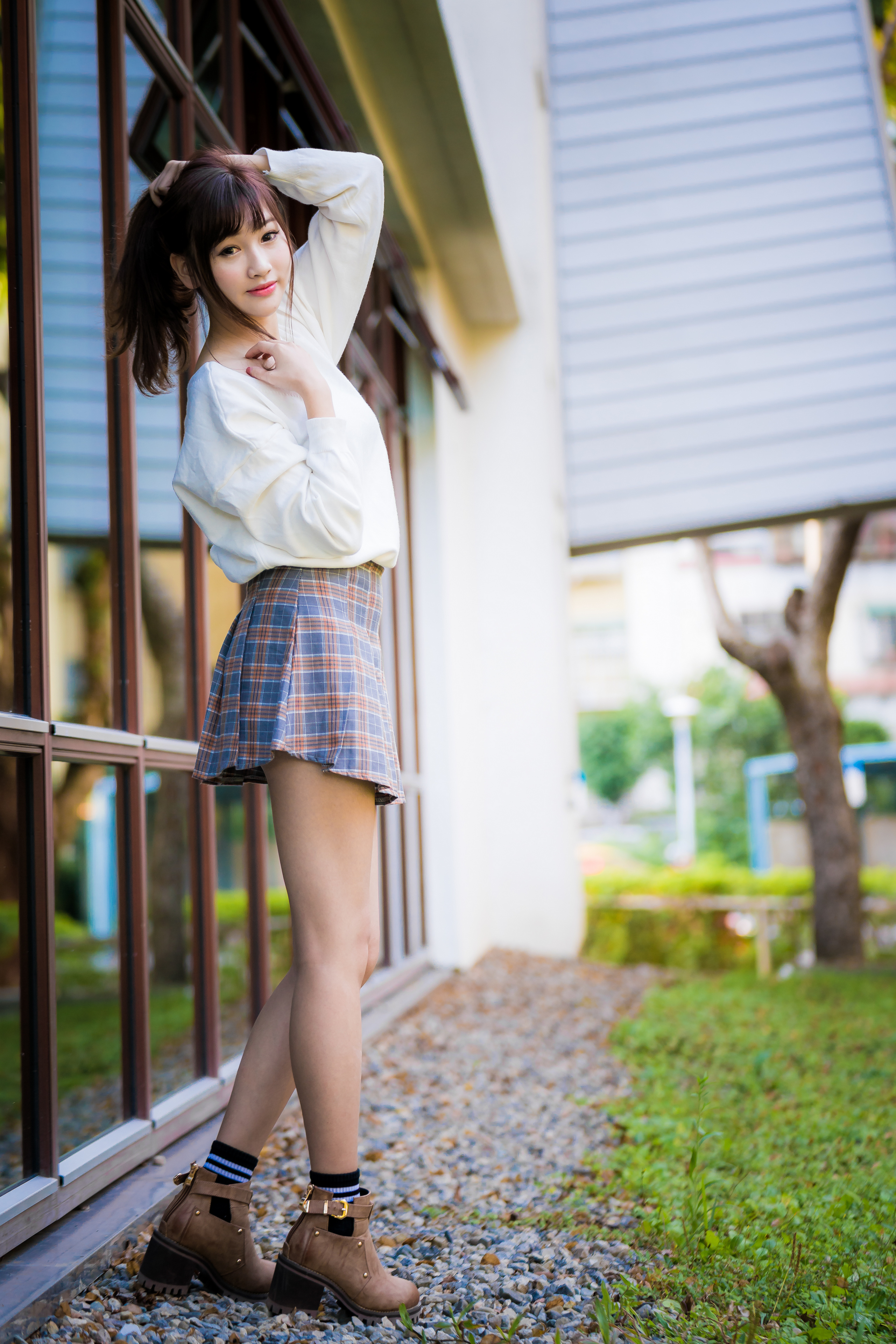 Photos Skirt Bokeh posing young woman Legs Asiatic Staring  for Mobile phone blurred background Pose Girls female Asian Glance
