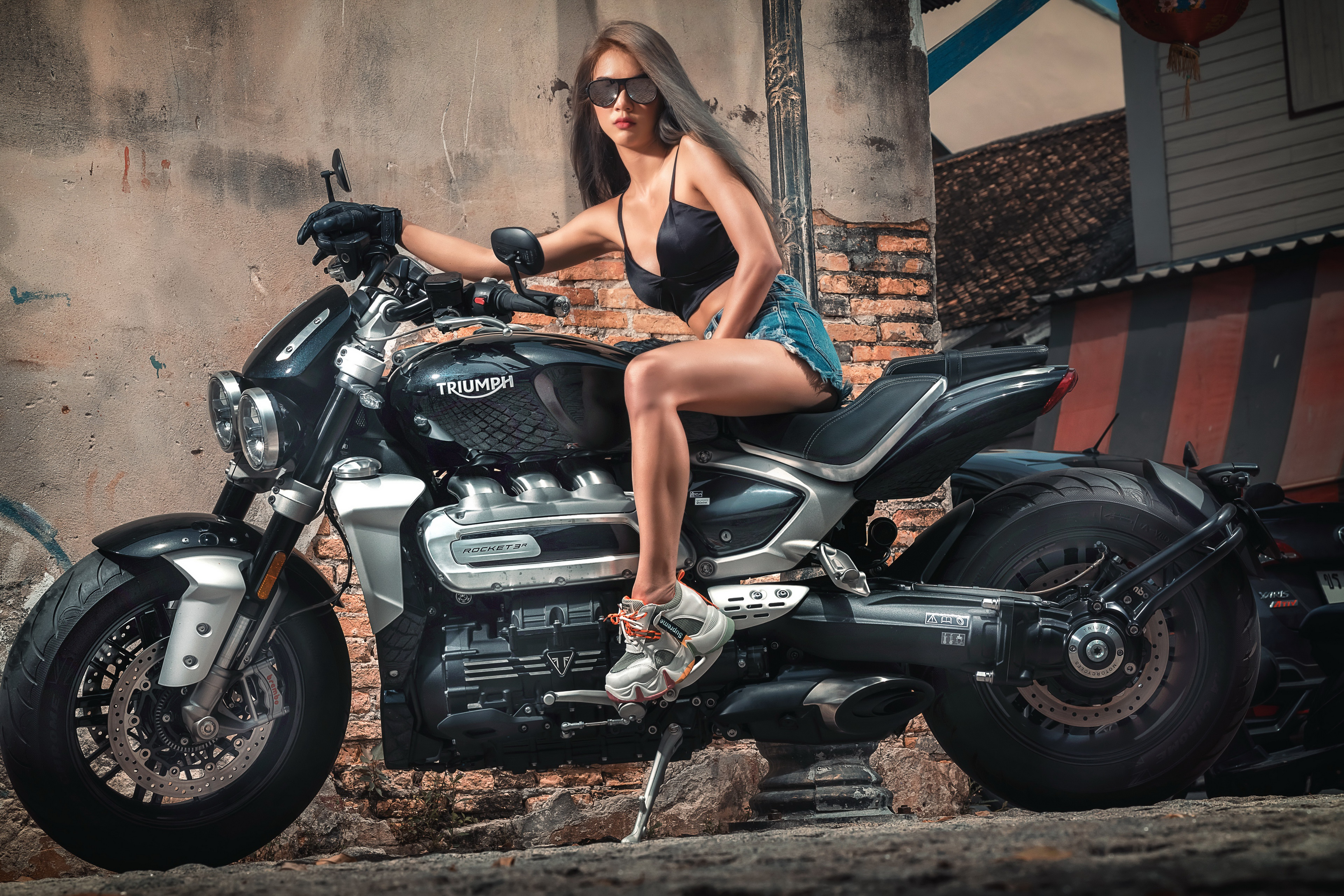 Photos Triumph Motorcycles Ltd Girls motorcycle Asian sit Shorts eyeglasses 3840x2561 Triumph female young woman Motorcycles Asiatic Glasses Sitting