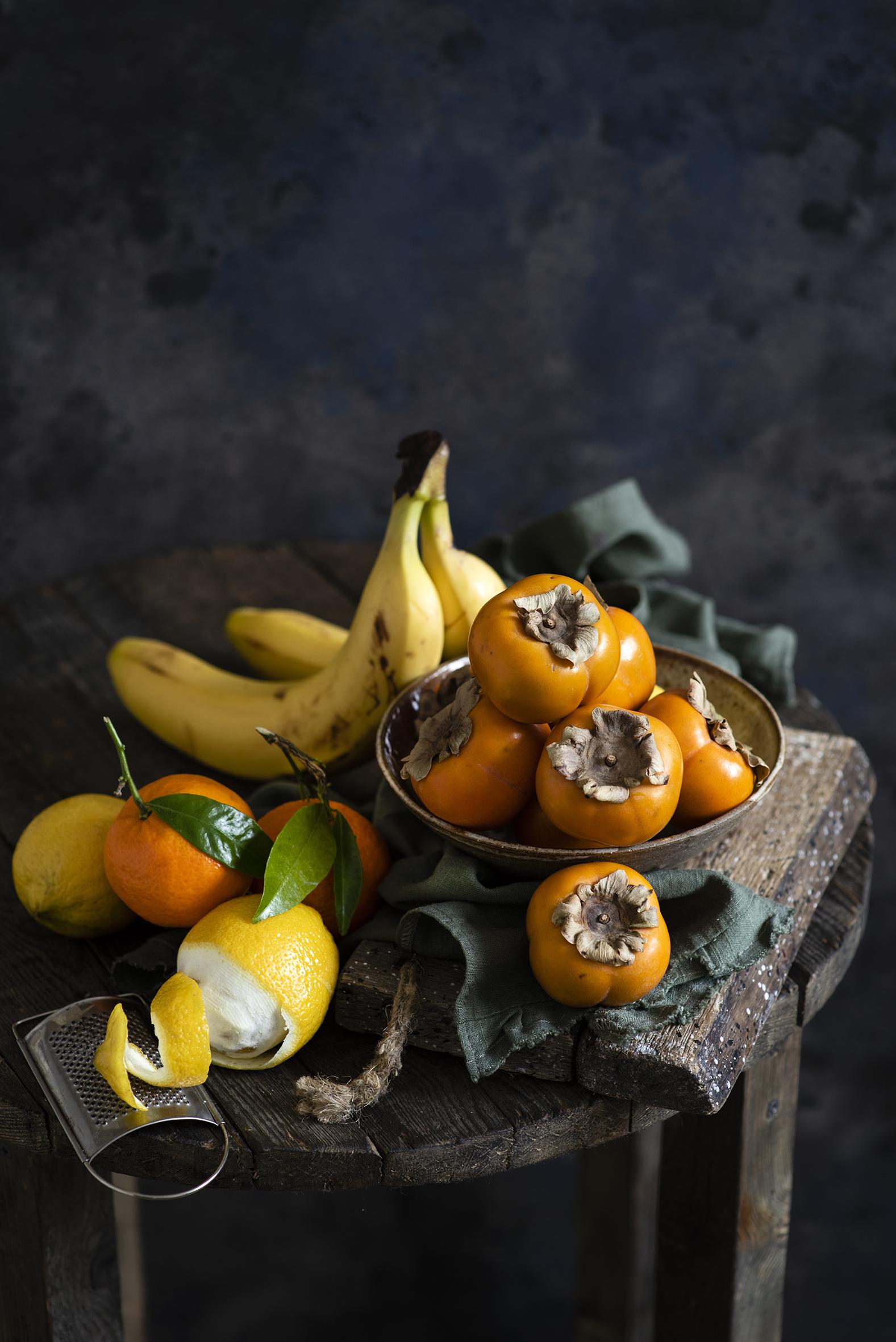 Foto Kaki Orange Frucht Bananen Zitrone Obst Lebensmittel Stillleben  für Handy Apfelsine Zitronen das Essen