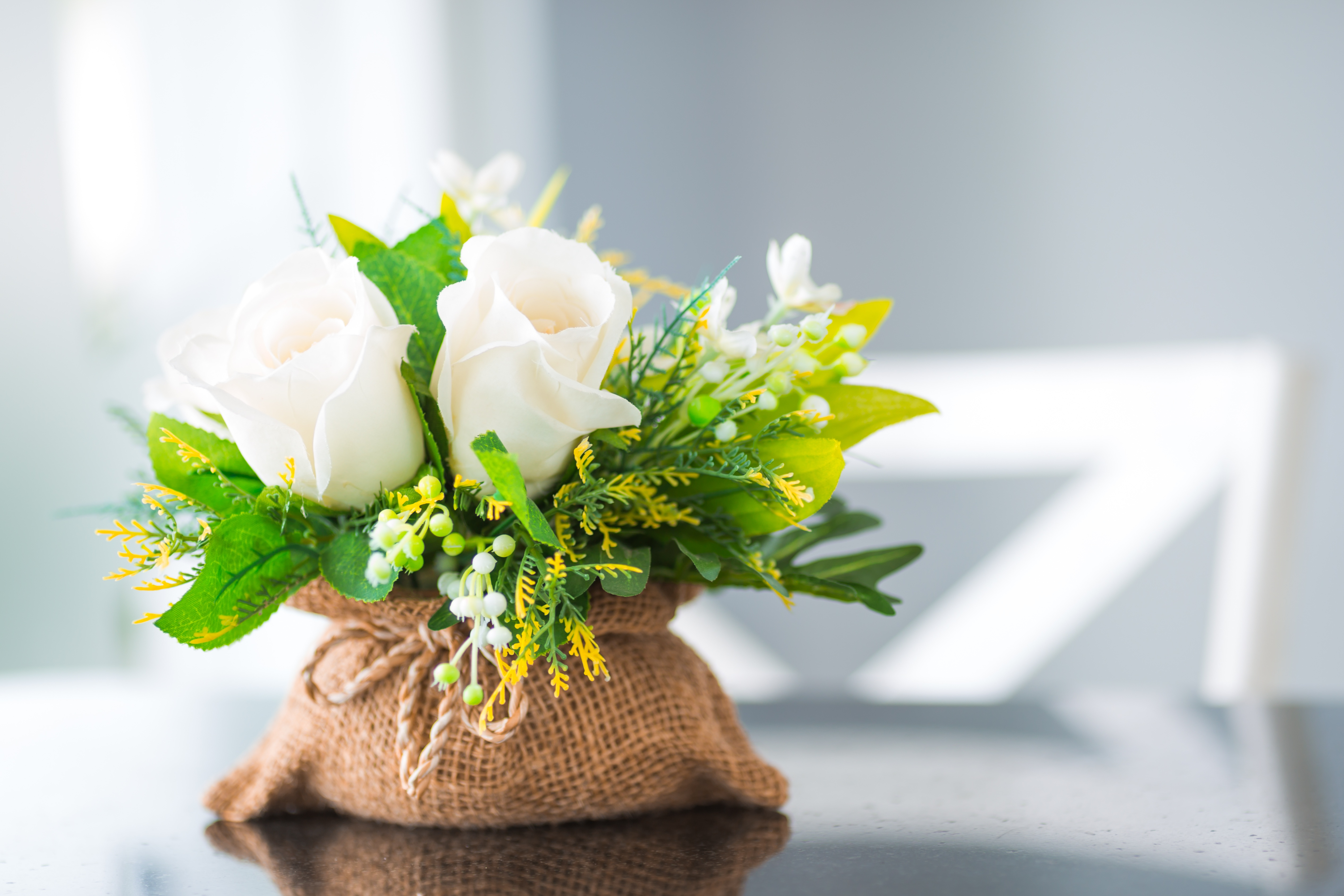 Desktop Wallpapers Bokeh Bouquets rose flower Lilies of the valley Table blurred background bouquet Roses Flowers