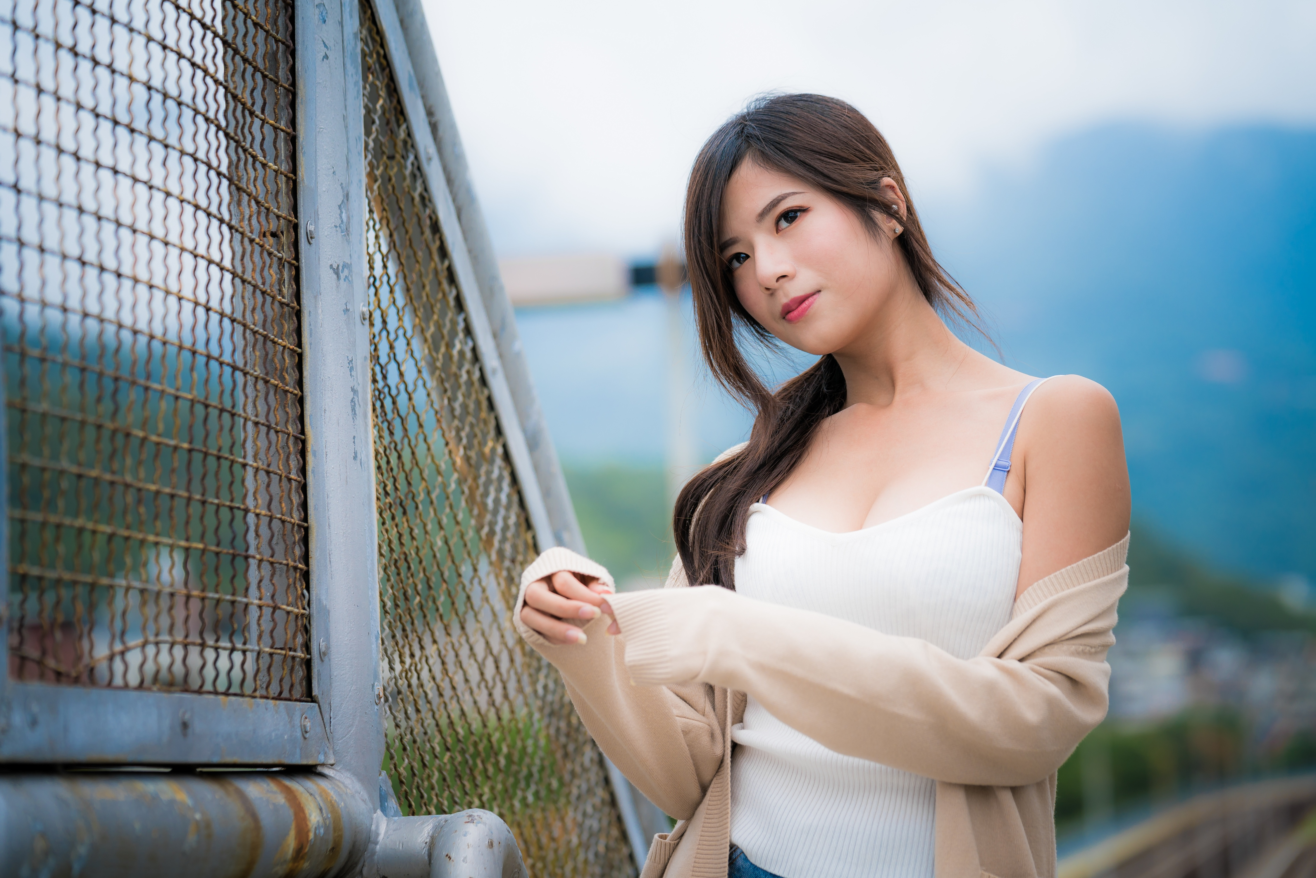 Image Brunette girl Bokeh female Asian Hands Glance 4500x3002 blurred background Girls young woman Asiatic Staring