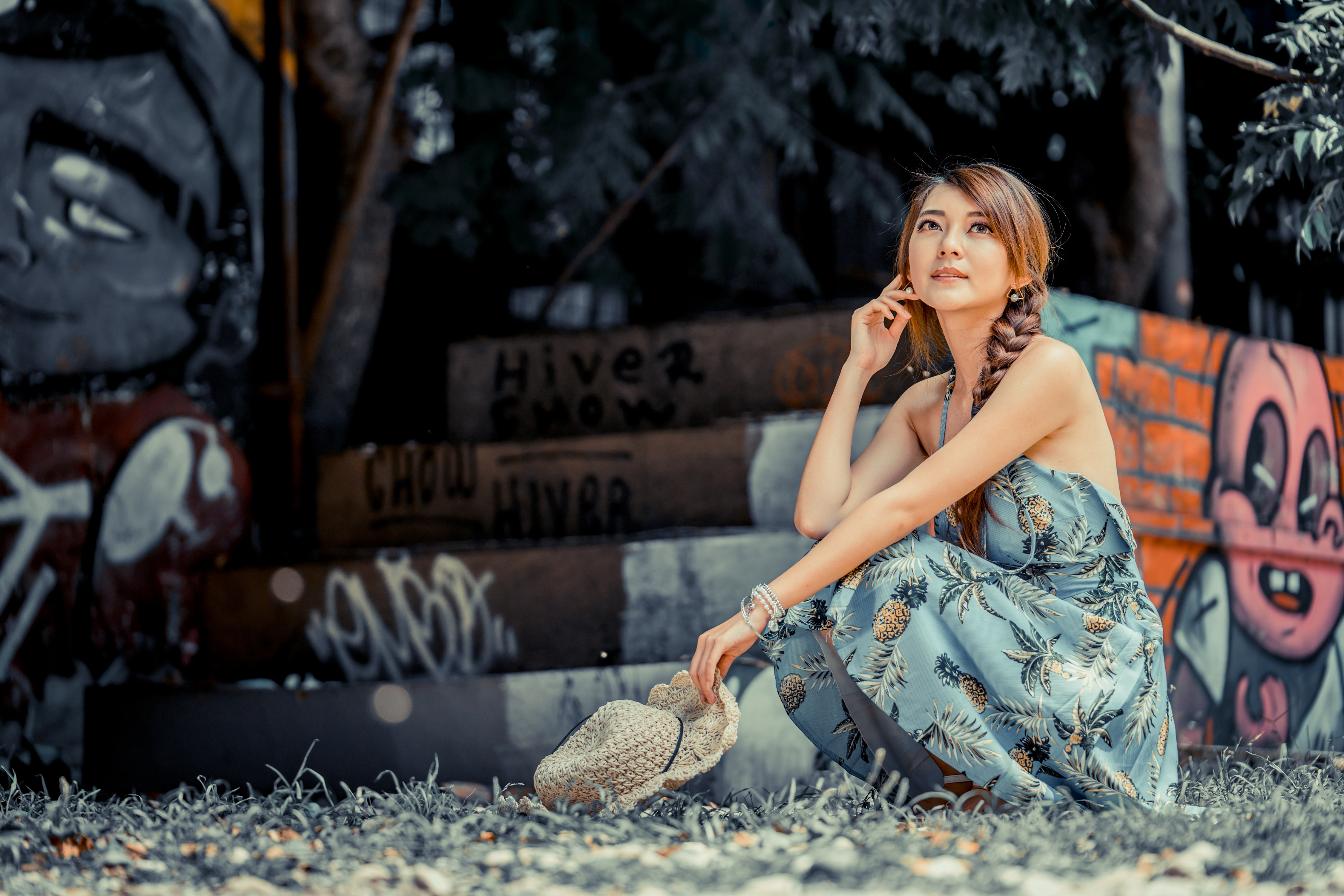 Photos Brown haired Bokeh Hat Girls Asiatic sit Hands frock 4500x3002 blurred background female young woman Asian Sitting gown Dress