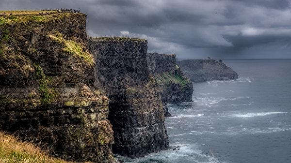 Desktop Wallpapers Ireland Clare, Cliffs of Moher storm cloud Sea Crag Nature 600x337 Thundercloud Rock Cliff