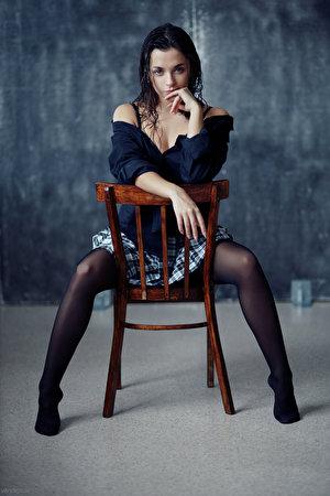Fotos von Evgeniy Bulatov Rock Nastya Bluse junge Frauen Bein Hand Stuhl sitzt Blick 300x450 für Handy Mädchens junge frau sitzen Stühle Sitzend Starren