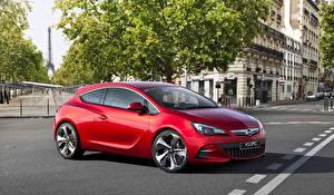 Fotos Opel Frankreich Rot Seitlich Metallisch Asphalt 2010 GTC auto Städte