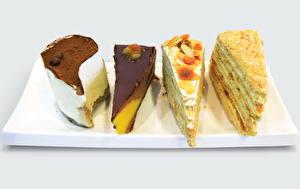 Hintergrundbilder Süßware Torte Schokolade Farbigen hintergrund Lebensmittel