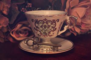 Fotos Großansicht Tasse Untertasse Schlüssel