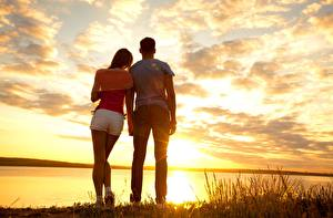 Photo Sunrise and sunset Couples in love Sky Man Jeans Shorts Clouds Dating Nature Girls