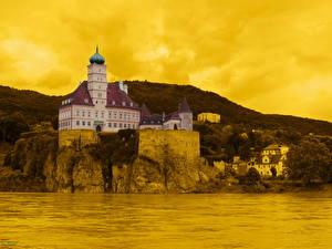 Bureaubladachtergronden Burcht Oostenrijk Geel kleur Schoenbuehel Steden