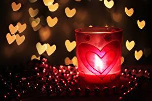 Bilder Großansicht Kerzen Flamme Valentinstag Herz Trinkglas