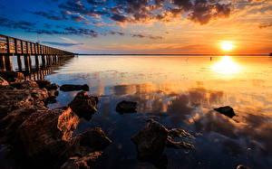 Bilder Sonnenaufgänge und Sonnenuntergänge Küste Steine Wasser Landschaftsfotografie Sonne Horizont Natur