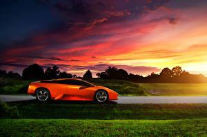 Pictures Lamborghini Sunrises and sunsets Orange Side auto
