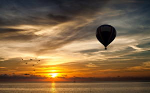 Pictures Sky Sunrises and sunsets Balloon (aeronautics) Clouds Nature Sport