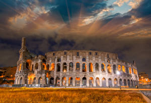 Pictures Italy Famous buildings Ruins Sky Colosseum Rome Arch Cities