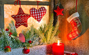 Fotos Neujahr Feiertage Kerzen Ast Kugeln Herz