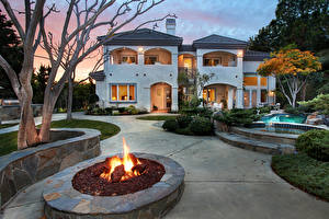 Pictures USA Houses Flame California Mansion Swimming bath Lawn Night San Juan Capistrano Cities